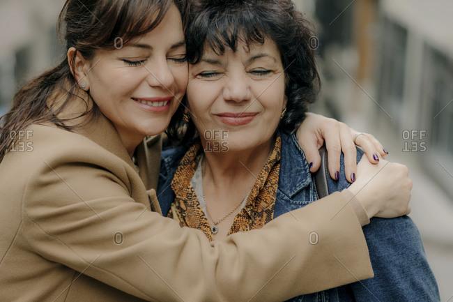 Portrait of happy woman hugging her mother