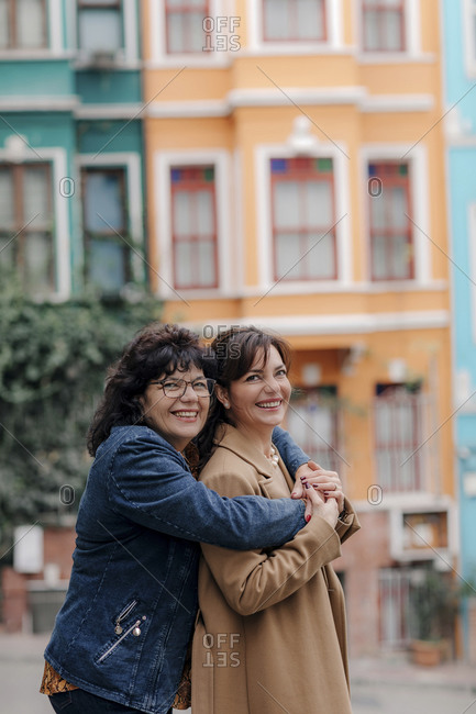 Portrait of happy mother hugging adult daughter on the street- Istanbul- Turkey