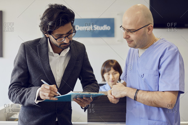 Patient and dentist at reception of a dental practice
