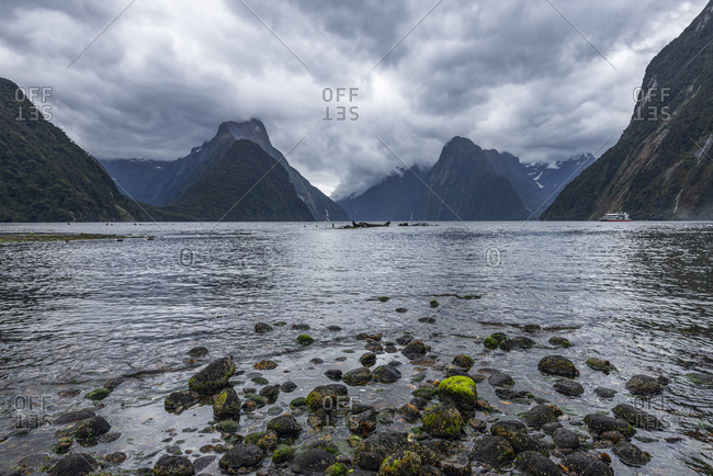 New Zealand- Southland- Storm clouds over scenic coastline of Milford Sound