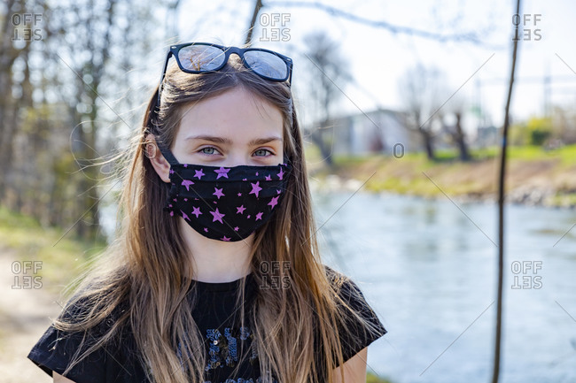 Girl with homemade protective mask at riverside