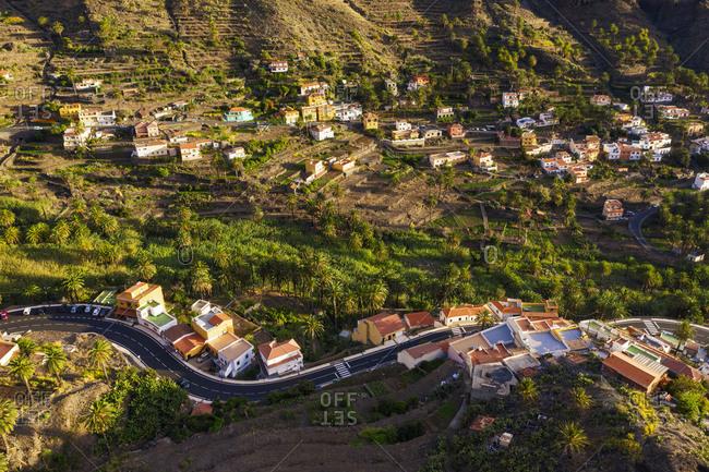 Spain- Santa Cruz de Tenerife- Valle Gran Rey- Aerial view of village houses on La Gomera at dusk