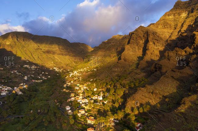 Spain- Santa CruzdeTenerife-ValleGran Rey- Aerial view of village in mountain valley at dusk
