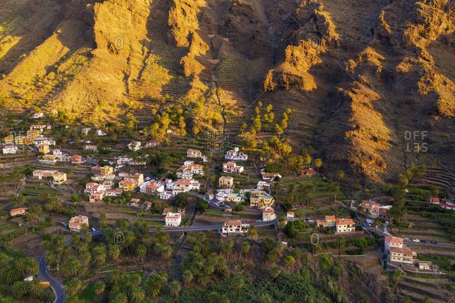 Spain- Santa CruzdeTenerife-ValleGran Rey- Aerial view of village houses on LaGomeraat dusk