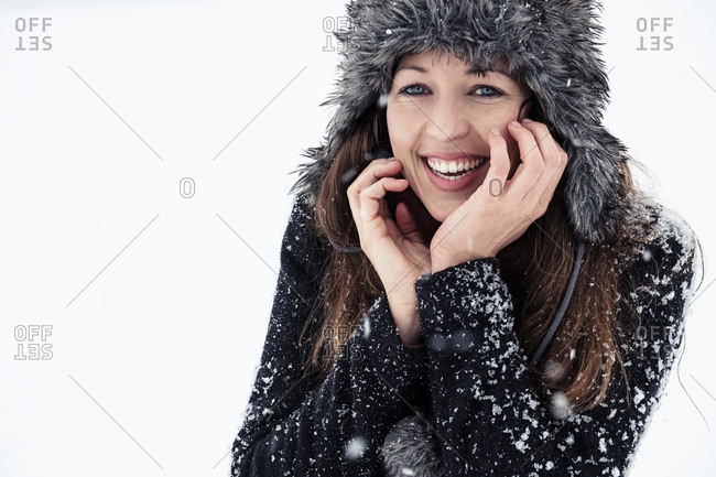 Portrait of laughing young woman in winter
