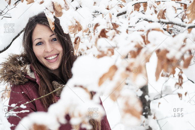 Portrait of happy young woman enjoying nature in winter