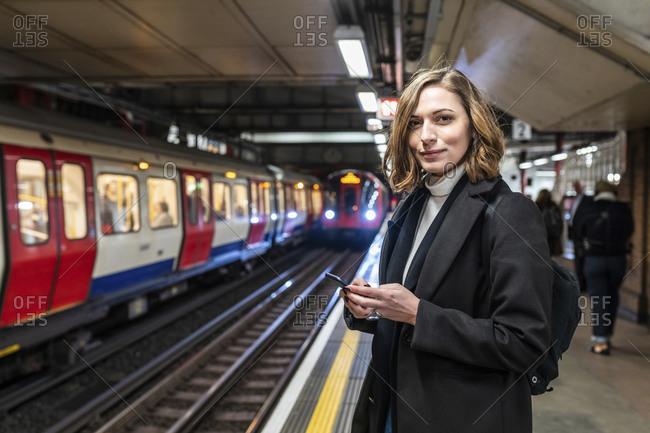 Portrait of confident woman at the subway station- London- UK