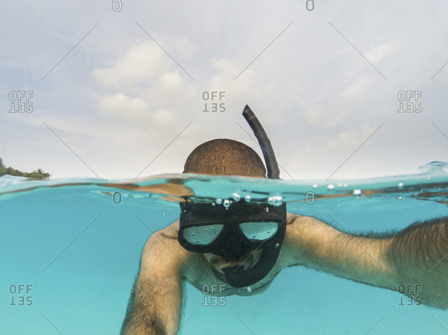 Man snorkeling on the water surface