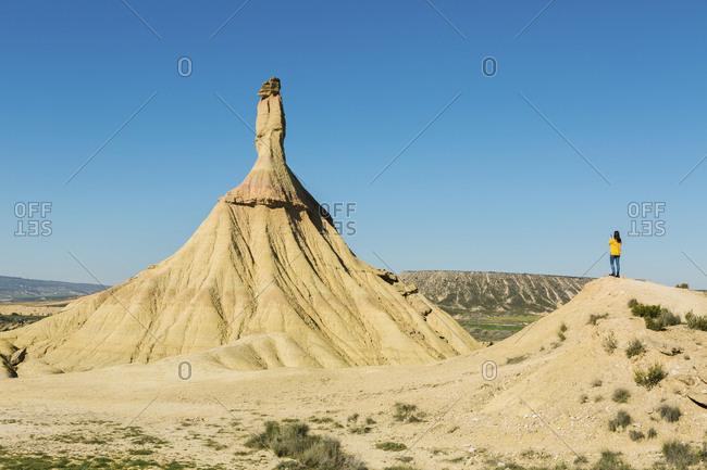 Woman in desertic landscape of Bardenas Reales- Arguedas- Navarra- Spain