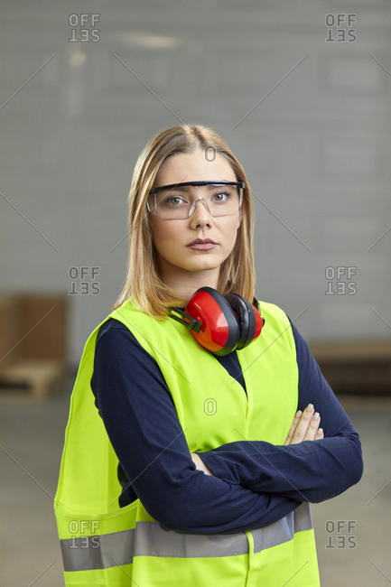 Portrait of confident female worker in protective workwear