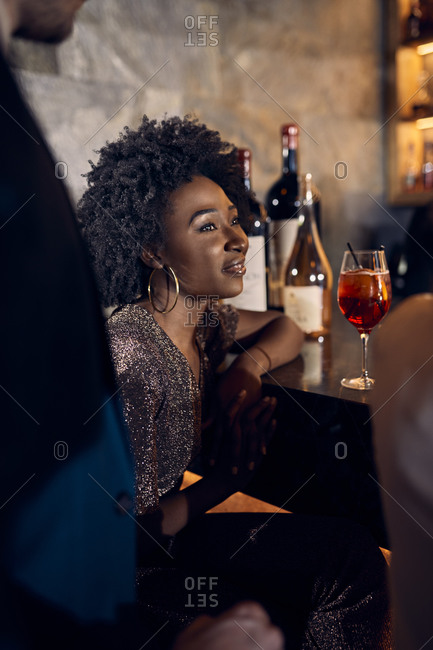 Portrait of woman with friends in a bar