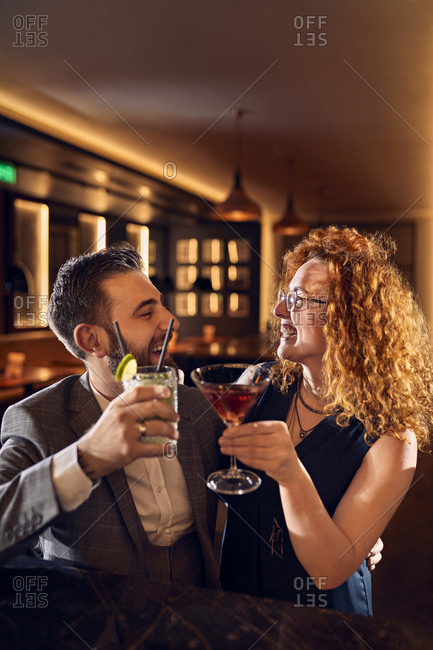 Happy couple socializing in a bar