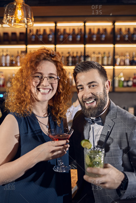 Portrait of happy couple socializing in a bar