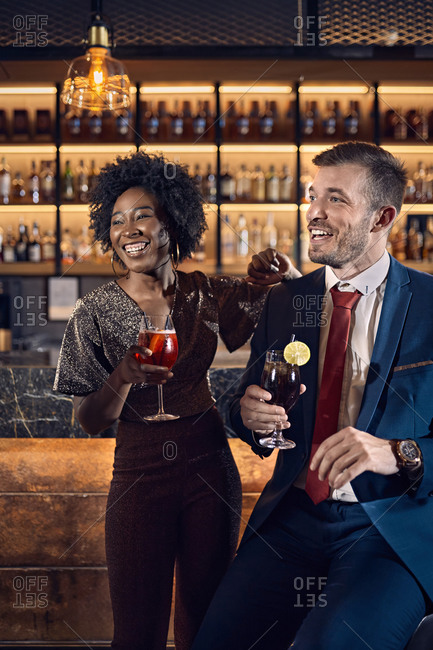 Cheerful couple socializing in a bar