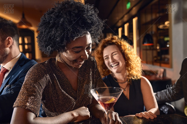 Cheerful friends socializing in a bar