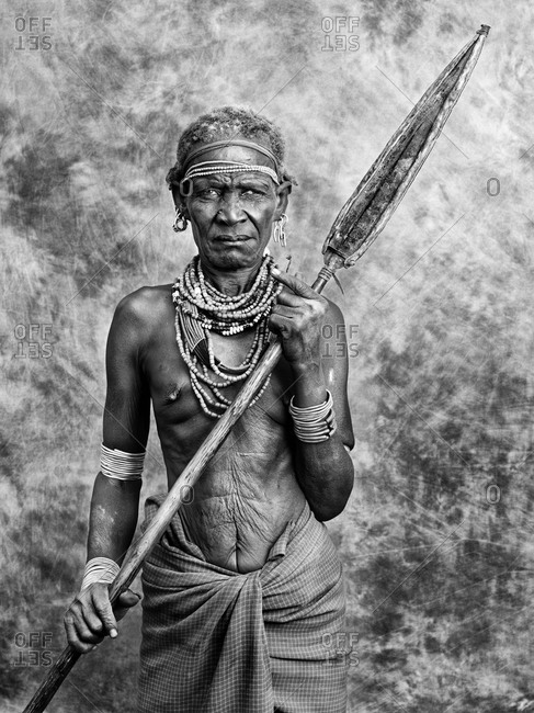 Gambela, Gambella, Ethiopia - April 4, 2012: AN OLD DASSANECH WOMAN HUNTING COCODRILES