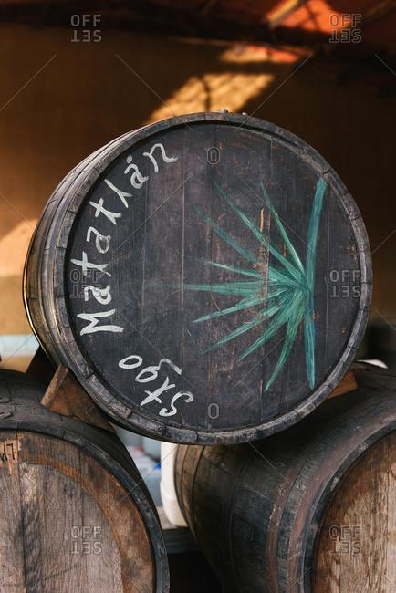 Santiago Matatlan, Oax., Mexico - March 14, 2018: Barrels for aging mezcal stacked up in a distillery in Oaxaca