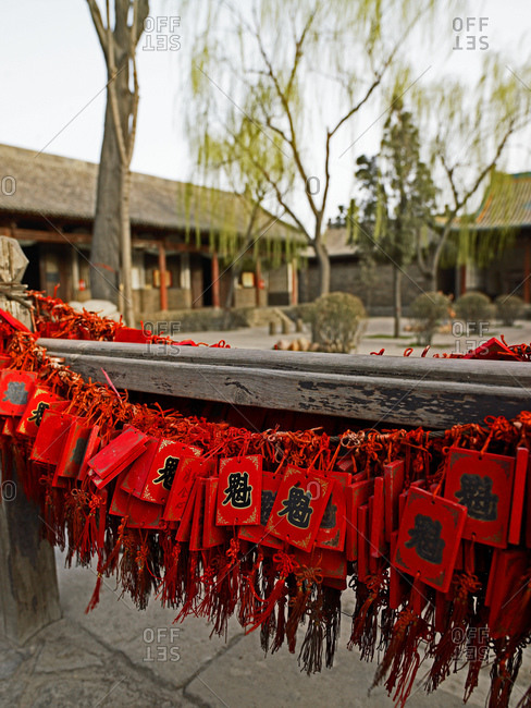 Taiyuan, Shanxi, China - July 13, 2011: Lucky pendants on red strings in Pingyao / China