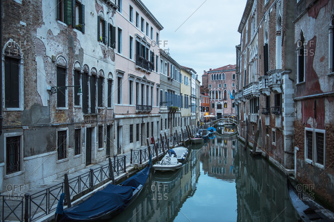 Venice, Veneto, Italy - April 13, 2018: narrow canal in Venice after sunset