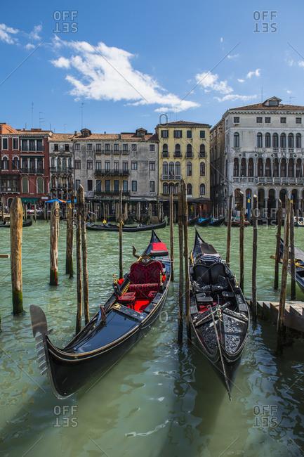 Venice, Veneto, Italy - April 13, 2018: Gondolas parked at canal grande in Venice
