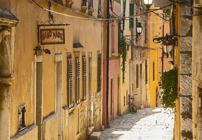 Rovinj, Istria County, Croatia - April 20, 2019: cobblestone street in Rovinj / Croatia