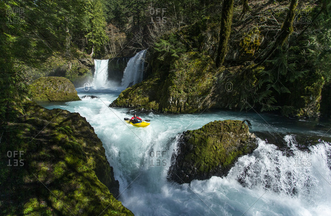 White Salmon, WA, United States - March 18, 2020: A kayaker descends the Little White Salmon River in WA.