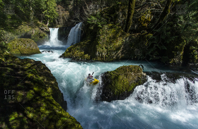 White Salmon, WA, United States - March 18, 2020: A kayaker descends the Little White Salmon River in the WA.