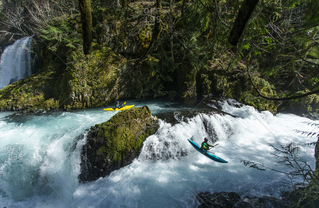 White Salmon, WA, United States - March 18, 2020: Two kayakers descends the Little White Salmon River in WA.