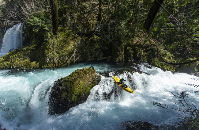 White Salmon, WA, United States - March 18, 2020: A kayaker descend the Little White Salmon River in WA.