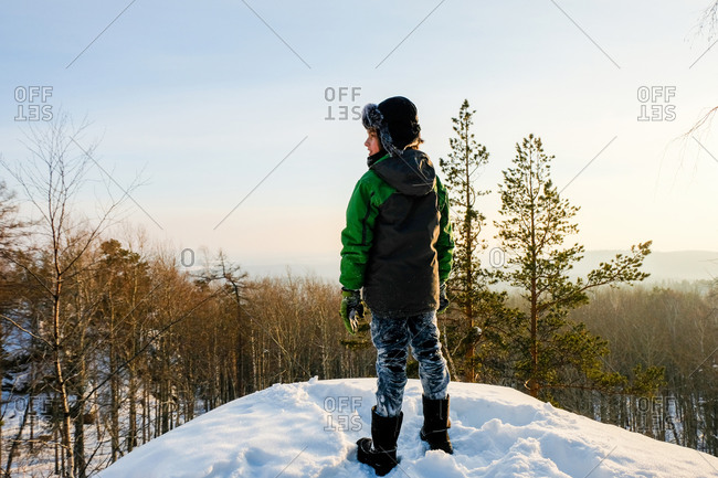 Severe hiker walking along the mountain path route. The Urals landscape