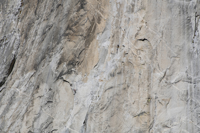 Two climber big walling on el Capitan with haul bags and aid climbing