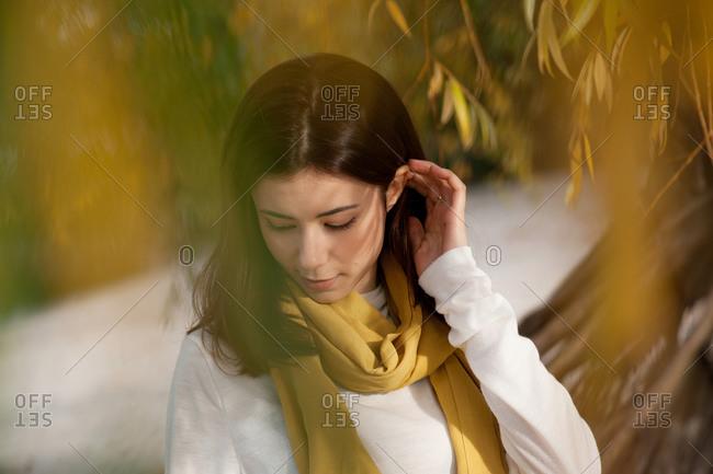 Beautiful brunette walks autumn in the park