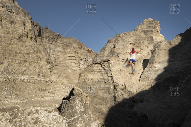 One man descending on a sandy and steep terrain at an old mining area