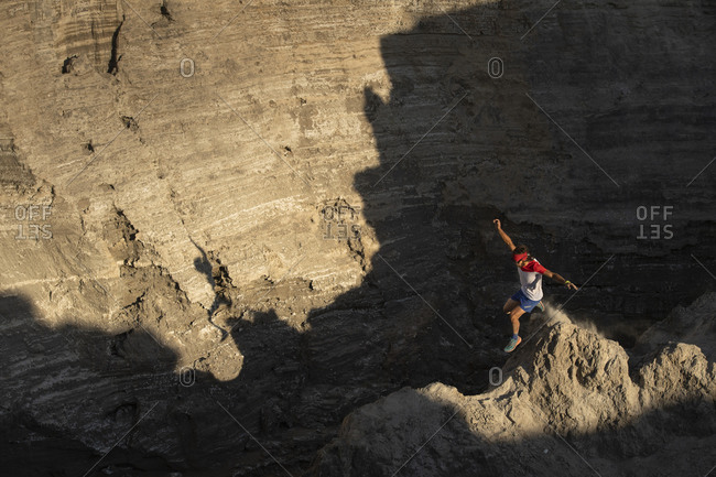 One man trail running down through a ridge on a sandy terrain