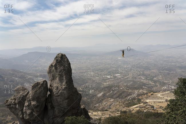 One man walking on a highline at Los Frailes near El Arenal, Hidalgo