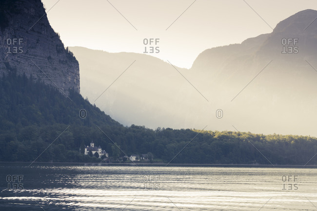 Mid distant view of Schloss Grub under cliff by Hallstatter See