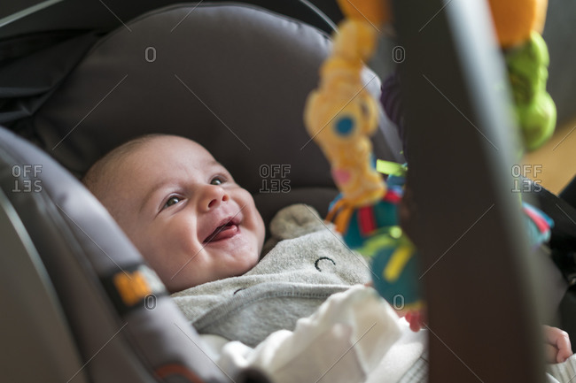 High angle view of smiling baby in car seat