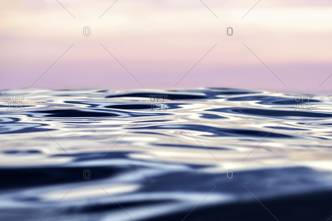 Sunset with smooth sea, close up waves