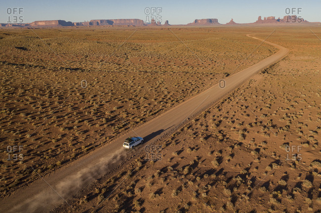 Tacoma Truck long desert road toward Iconic Monument Valley Arizona
