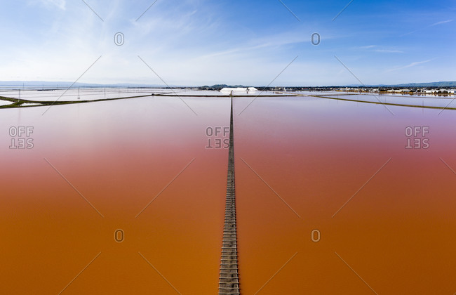 Aerial of Vivid Pink Salt Evaporation Ponds in SF Bay Marshland