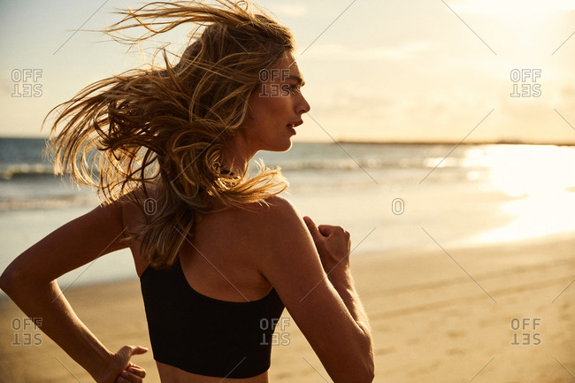 Young girl running on Southern California beach.