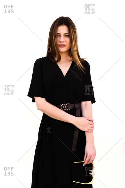 Attractive Caucasian woman poses in an elegant black dress