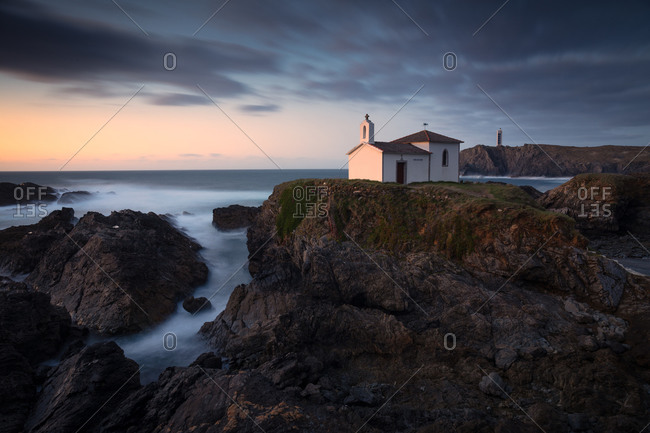 Oneiric seascape with a hermitage on the coast