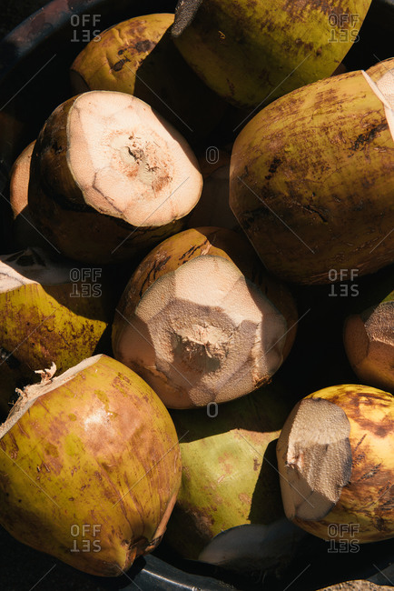 Fresh coconuts for sale by roadside vendor in Caribbean
