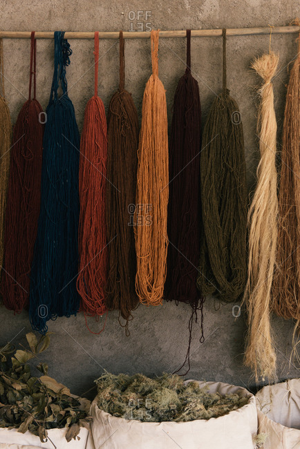 Wool hangs from a natural dye artisan studio in Oaxaca