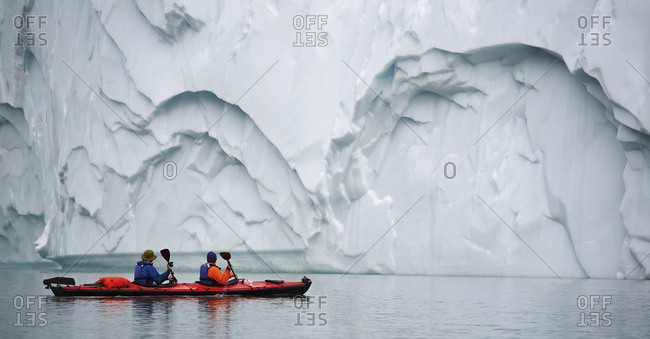 2 men traveling with a sea kayak in Eastern Greenland