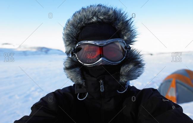 Portrait of mature man at camp on Icelandic glacier