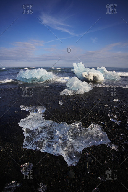 Stranded icebergs on black sand beach in south east Iceland