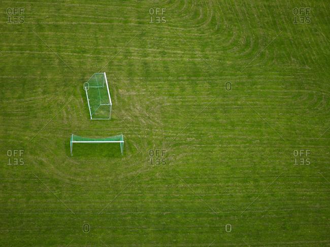 Aerial shot of football goals on an empty field