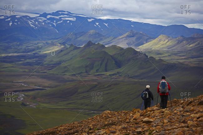 Hiker descending into a valley on the Laugavegur trek